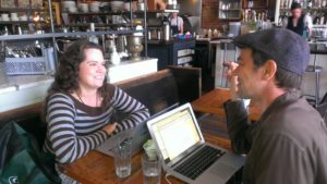 Eve Rickert and Stefan Schaefer working on their pitch for the New Ventures BC competition, at Seattle's Oddfellows Cafe at the end of May. © Talk Science to Me Communications Inc. 2013