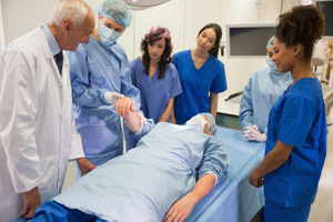 Medical students learning from professor.